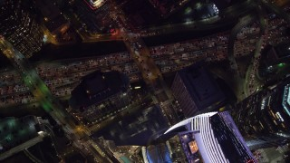 AX0158_123 - 8K stock footage aerial video of a bird's eye orbit of Wilshire Grand Center and nighttime traffic on the 110 Freeway in Downtown Los Angeles, California
