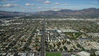 AX0159_001 - 8K stock footage aerial video flying over suburban neighborhoods, Pacoima, San Fernando Valley, California