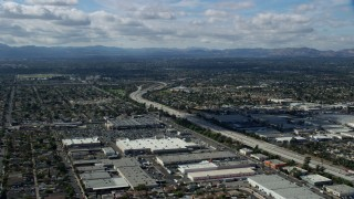 AX0159_002 - 8K stock footage aerial video flying over the 118 freeway and warehouses, Pacoima, San Fernando Valley, California