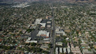 AX0159_004 - 8K stock footage aerial video flying over Glenoaks Blvd and shopping centers, Sylmar, California