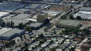 AX0159_006 - 8K stock footage aerial video flying over warehouses in Sylmar industrial area, San Fernando Valley, California