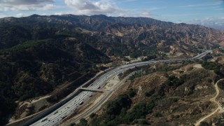 AX0159_011 - 8K stock footage aerial video flying over I-5 with light traffic, Santa Clarita, California