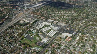 AX0159_013 - 8K stock footage aerial video of Wiley Canyon Elementary School, storage facilities and retail spaces, Santa Clarita, California