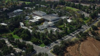 AX0159_018 - 8K stock footage aerial video orbiting the campus of California Institute of the Arts, Santa Clarita, California