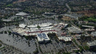 AX0159_027 - 8K stock footage aerial video of a high orbit of a shopping mall, Santa Clarita, California