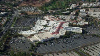 AX0159_028 - 8K stock footage aerial video orbiting and zooming in on shopping mall, Santa Clarita, California