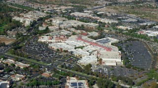AX0159_029 - 8K stock footage aerial video of a reverse orbit of a shopping mall and parking lot, Santa Clarita, California