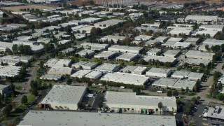 AX0159_034 - 8K stock footage aerial video of office buildings and warehouses, Valencia, California