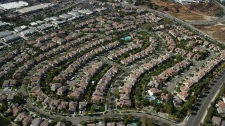 AX0159_036 - 8K stock footage aerial video flying over tract homes, Valencia, California