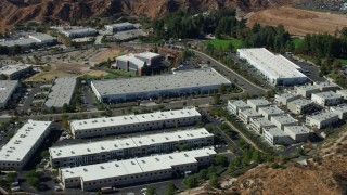 AX0159_037 - 8K stock footage aerial video orbiting tech office buildings, Valencia, California