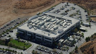 AX0159_038 - 8K stock footage aerial video orbiting a tech office building, Valencia, California