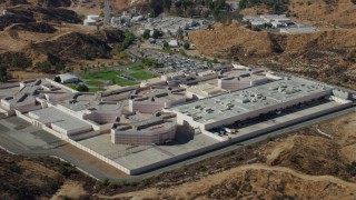 AX0159_042 - 8K stock footage aerial video orbiting a supermax correctional facility, Valencia, California