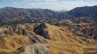 AX0159_052 - 8K stock footage aerial video flying over roads in the hills, Canyon Country Foothills, California