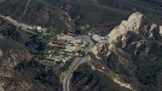 AX0159_057 - 8K stock footage aerial video of a religious retreat center nestled in the canyons, Sylmar, California