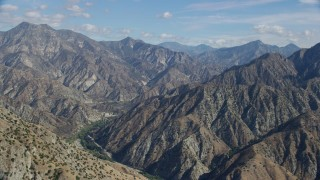 AX0159_059 - 8K stock footage aerial video revealing canyon and mountain ridges, Sunland-Tujunga, California
