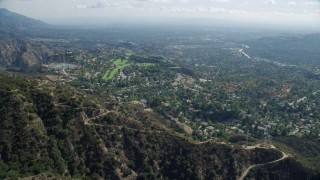 AX0159_064 - 8K stock footage aerial video revealing a residential community and country club, La Cañada Flintridge, California