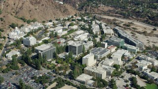 AX0159_071 - 8K stock footage aerial video of close up orbit of buildings on NASA JPL campus, Pasadena, California