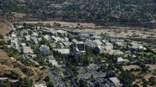 AX0159_072 - 8K stock footage aerial video flying away from research and development center, JPL, Pasadena, California