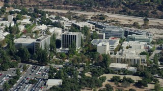 AX0159_078 - 8K stock footage aerial video of parking lot and research and development buildings at JPL, Pasadena, California