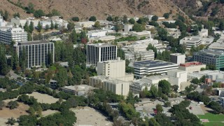 AX0159_079 - 8K stock footage aerial video close up orbiting of research and development buildings on JPL campus, Pasadena, California