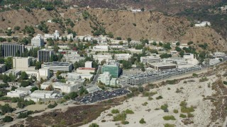 AX0159_080 - 8K stock footage aerial video of a Jet Propulsion Laboratory campus against the hillside, Pasadena, California