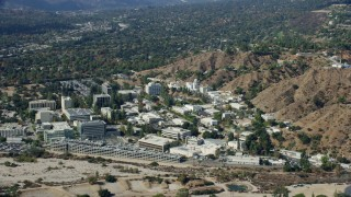 AX0159_082 - 8K stock footage aerial video of a parking garage and buildings of scientific facilities campus, JPL, Pasadena, California