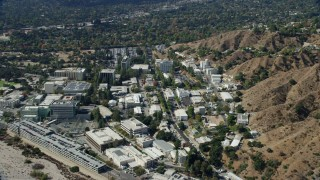 AX0159_083 - 8K stock footage aerial video approaching and flying over research buildings at JPL, Pasadena, California