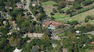 AX0159_090 - 8K stock footage aerial video orbiting Chevy Chase Country Club, Glendale CA