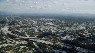 AX0159_093 - 8K stock footage aerial video approaching interchange near office buildings, Pasadena, California