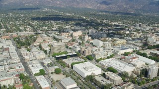 AX0159_095 - 8K stock footage aerial video orbiting downtown office buildings, businesses and shops near City Hall, Pasadena, California