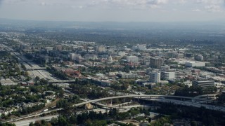 AX0159_103 - 8K stock footage aerial video of Pasadena City Hall and office buildings across the 134 freeway, Pasadena, California