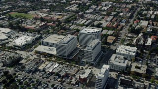AX0159_108 - 8K stock footage aerial video circling office buildings in Pasadena, California