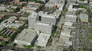 AX0159_109 - 8K stock footage aerial video orbiting office buildings in Pasadena California