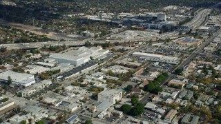 AX0159_111 - 8K stock footage aerial video of office buildings and a large warehouse beside I-210 in Pasadena, California