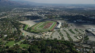 AX0159_112 - 8K stock footage aerial video approaching the Santa Anita Park horse racing track from neighborhoods in Arcadia, California