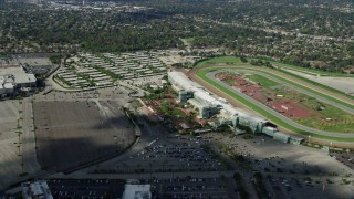 AX0159_115 - 8K stock footage aerial video orbiting the Santa Anita Park horse race track and parking lot in Arcadia, California