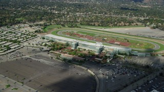 AX0159_116 - 8K stock footage aerial video orbiting the Santa Anita Park horse racing track in Arcadia, California