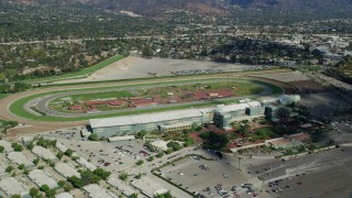 AX0159_117 - 8K stock footage aerial video orbiting the Santa Anita Park horse racing track in Arcadia, California