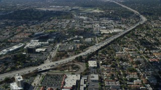 AX0159_121 - 8K stock footage aerial video of a reverse view of traffic stopped by CHP on 210 Freeway in Arcadia, California
