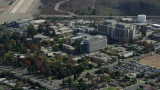 AX0159_123 - 8K stock footage aerial video approaching the City of Hope Medical Center in Duarte, California
