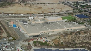 AX0159_126 - 8K stock footage aerial video of a brewery next to solar panels in Irwindale, California