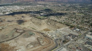 AX0159_127 - 8K stock footage aerial video flying by a large gravel quarry in Irwindale, California