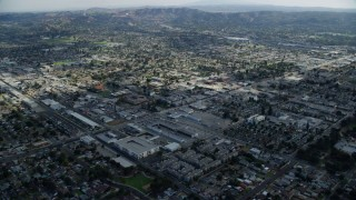 AX0159_128 - 8K stock footage aerial video flying over residential neighborhoods and city streets in Covina, California