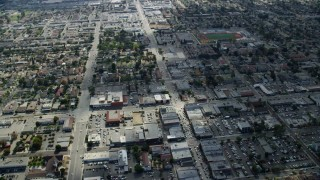 AX0159_129 - 8K stock footage aerial video of city streets, stores and neighborhoods in Covina, California