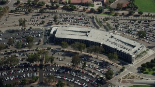 AX0159_132 - 8K stock footage aerial video approaching the Cal Poly parking garage in Pomona, California