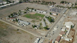 AX0159_143 - 8K stock footage aerial video circling buildings at the California Institution for Men, Chino, California