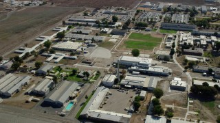 AX0159_146 - 8K stock footage aerial video flying by the California Institution for Men in Chino, California