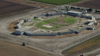 AX0159_147 - 8K stock footage aerial video flying by the East Yard of the California Institution for Men, Chino, California