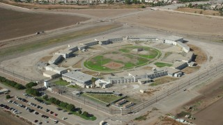 AX0159_149 - 8K stock footage aerial video of East Yard of the California Institution for Men, Chino, California