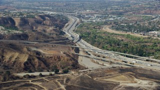 AX0159_157 - 8K stock footage aerial video of Highway 91 at Highway 241, Anaheim, California